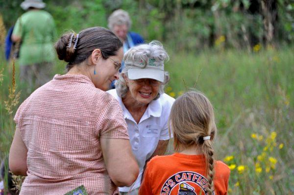Women teaching about Kansas wildflowers.