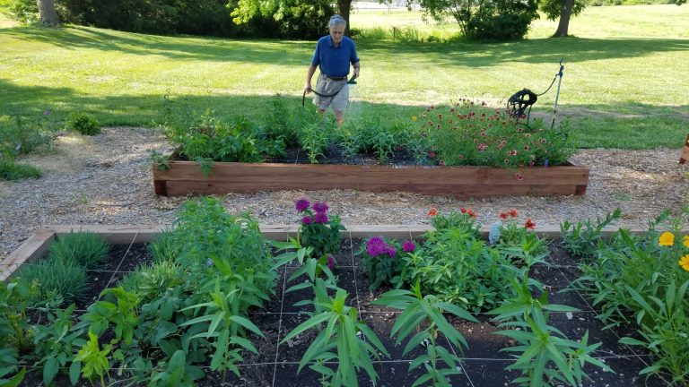 Watering New Pollinator Garden at Sister of Charity Motherhouse